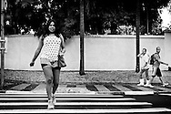 Raíca Soares was born in Várzea Alegre, in Ceará state. She began to feel different from other boys at the age of 8 but only at age of 20 she left parental home and went to São Paulo, where she would make the changes in her body. Raíca is watched by two men while walking to the gym where she goes 5 times a week.