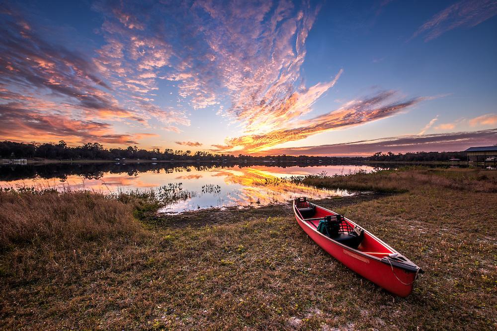 A kayak sits on the edge of McMeekin Lake in Hawthorne, FL ready for adventure.