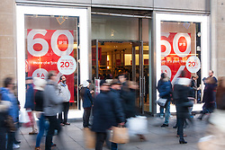 """London, December 20th 2014. Tens of thousands of shoppers descend on central London to scoop up pre-Christmas bargains as retailers offer discount incentives on """"Panic Saturday"""". PICTURED: High street stores are offering up to 60% discounts to lure shoppers in."""