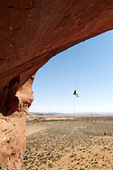 A rock climber rappels from the top of Looking Glass Rock near Moab, Utah.