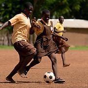 Girls play football (soccer) outside the Savelugu Junior Secondary School in Savelugu, Ghana on Tuesday June 5, 2007.