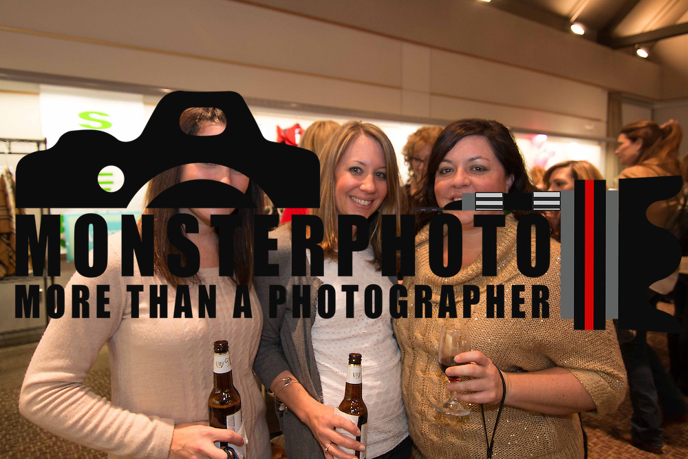 LEFT TO RIGHT: Corina Bacon, Courtney Kelly and Carey Manza pose for a photo during the 3rd Annual Guilty Girls Warehouse Sale Friday, Feb. 06, 2015 at University of Delaware's Arsht Hall in Wilmington, DE.