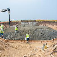 wind turbine base construction filling in concrete