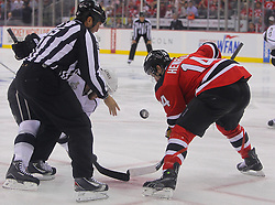May 30; Newark, NJ, USA; New Jersey Devils center Adam Henrique (14) takes a face-off during the first period of 2012 Stanley Cup Finals Game 1 at the Prudential Center.  The Kings defeated the Devils 2-1.