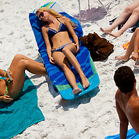SARASOTA, FL -- June 14, 2011 --  Kali Gough, 17, left, and Allie Harris, 18, center, all of Sarasota, apply sunscreen as they prepare to lay out at Siesta Public Beach in Sarasota, Fla., on Tuesday, June 14, 2011.
