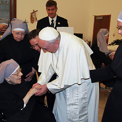 Pope Francis talks with Sister Marie Mathilde, 102, during his unannounced visit to the Little Sisters of the Poor residence in Washington Sept. 23. (CNS photo/courtesy of the Little Sisters of the Poor) See POPE-LITTLESISTERS Sept. 23, 2015.