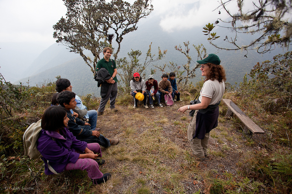 Carmen Giusti, the environmental education coordinator for ACCA is explaining the importance of cloud forests to a group of school children from the Queros-Wachiperi Native Community. The children are visiting the Wayqecha Cloud Forest Research Center 1,450 acre research center which protects cloud forest on the Eastern slopes of Andes in the Kcosñipata Valley, Peru (3000 meters above sea level).  Wayqecha is  run by the Amazon Conservation Association and the Asociación para la Conservación de la Cuenca Amazónica and is part of their strategy to protect the Amazon headwaters.