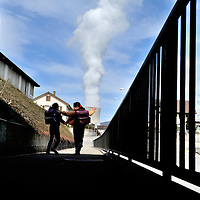 School children going home for lunch in a town close to G&ouml;sgen Nuclear Power Plant (Kernkraftwerk G&ouml;sgen), with smoke rising from its cooling tower. <br /> The Swiss are due to vote shortly in a referendum whether to quit nuclear power, which via its five reactors, on four sites, provide almost 40% of the country's power