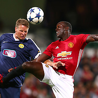 PERTH, AUSTRALIA - MARCH 25: Patrick Zwaanswijk of the PFA Aussie Legends and Dwight Yorke of the Manchester United Legends contest for the ball during the Manchester United Legends and the PFA Aussie Legends match at nib Stadium on March 25, 2017 in Perth, Australia.  (Photo by Paul Kane/Getty Images)