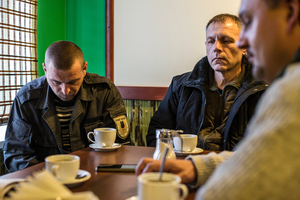 Yevgeny Kishkin, age 31, from Kakhovka in the Kherson region; Sergei Tkalenko, age 50, from Kiev; and Igor Slyusar, age 40, also from Kiev (from left), all members of the Black Tulips, sit for an interview on Wednesday, April 9, 2015 in Velyka Novosilka, Ukraine.