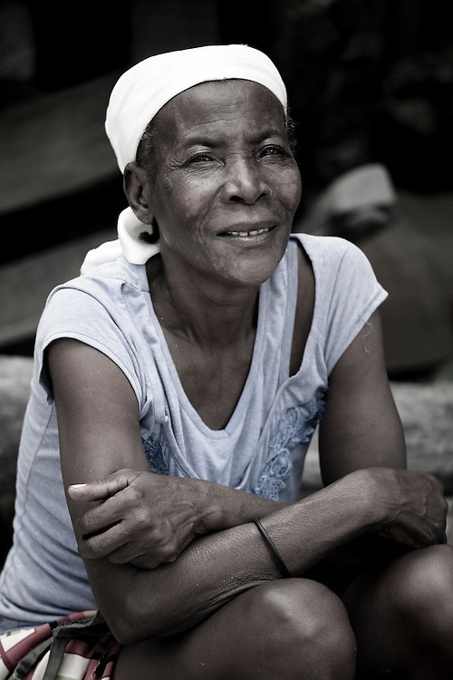 An elderly woman at the market in Marigot, Haiti, smiles for the camera