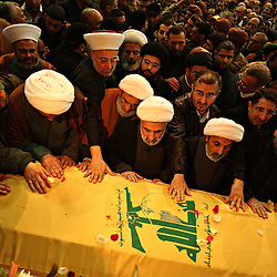 Hezbollah number two, Naim Qassem, center, prays over the coffin of slain militant commander Imad Mugniyeh in Beirut, Lebanon on Feb. 14, 2008. Imad Mugniyeh was killed in a mysterious car bombing in Damascus, Syria. Mugniyeh a.k.a. Hajj Radwan, was among the most feared terror operatives in the world.