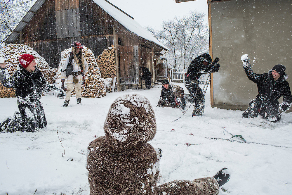Revelers in bear costumes celebrate the Malanka Festival with a snowball fight on Thursday, January 14, 2016 in Krasnoilsk, Ukraine. The annual celebrations, which consist of costumed villagers going in a group from house to house singing, playing music, and performing skits, began the previous sundown, went all night, and will last until evening.