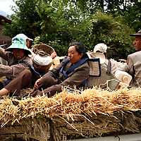 Workers on their way home after harvesting wheat just outside of Lijiang, the capital of Yunnan province in China. (Photo/Scott Dalton)