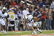 Ole Miss linebacker Denzel Nkemdiche (4) sacks Vanderbilt quarterback Jordan Rodgers (11) at Vaught-Hemingway Stadium in Oxford, Miss. on Saturday, November 10, 2012. (AP Photo/Oxford Eagle, Bruce Newman)