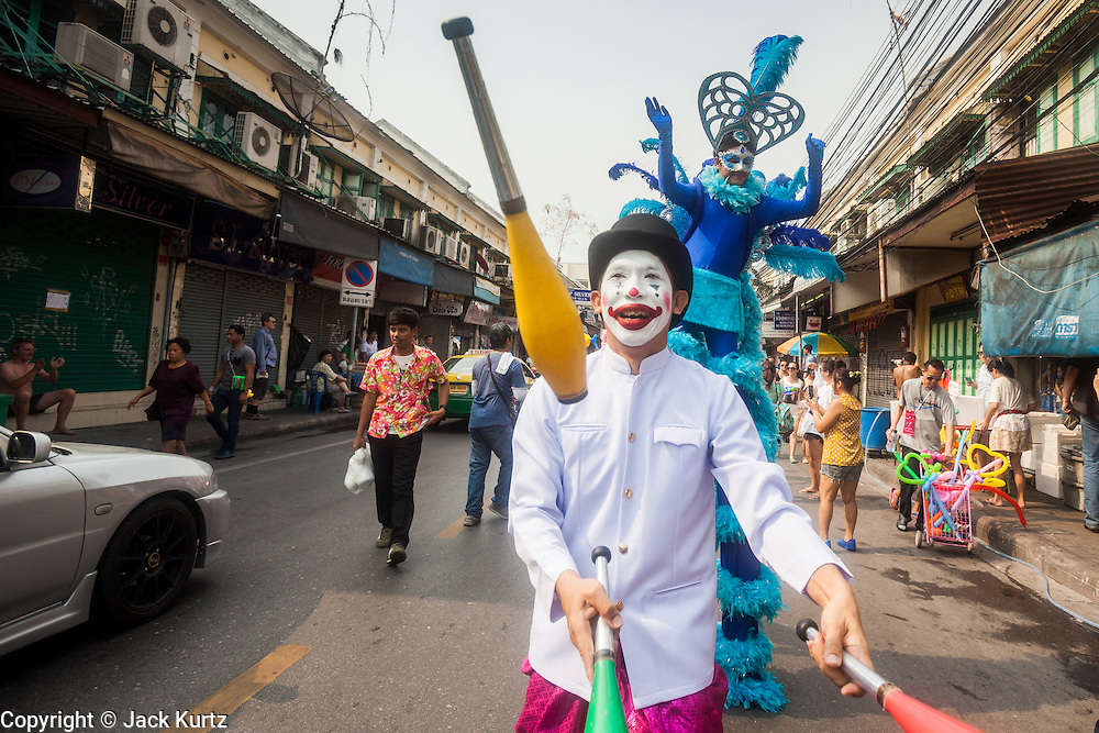 13 APRIL 2014 - BANGKOK, THAILAND:  A juggler performs in a Songkran parade near Khao San Road, Bangkok's backpacker street. Songkran is celebrated in Thailand as the traditional New Year's Day from 13 to 16 April. Songkran is in the hottest time of the year in Thailand, at the end of the dry season and provides an excuse for people to cool off in friendly water fights that take place throughout the country. Songkran has been a national holiday since 1940, when Thailand moved the first day of the year to January 1.      PHOTO BY JACK KURTZ