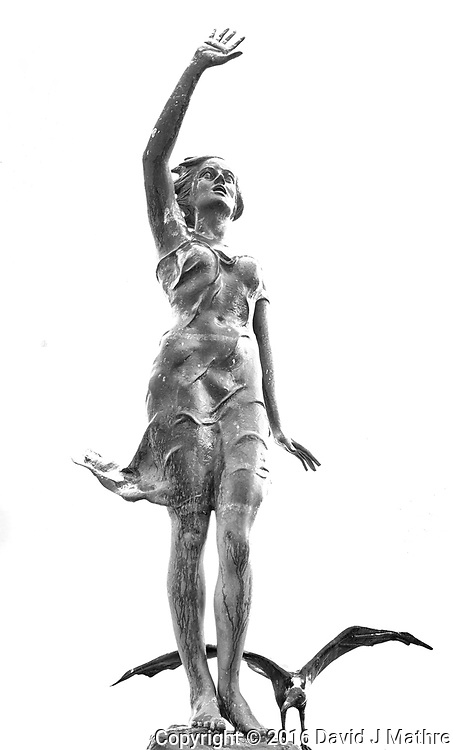 Bronze statue on the forward deck of the MV World Odyssey at the cruise terminal in Ensenada, Mexico.  Image taken with a Nikon N1 V3 camera and 10-30 mm lens (ISO 200, 19 mm, f/5.6, 1/20 sec).
