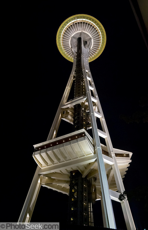 """The Space Needle (605 feet tall), at Seattle Center, Washington, USA. The Space Needle annually hosts more than 1 million visitors, making it the number one tourist attraction in the Pacific Northwest. When the Space Needle was built in 1962 for the World's Fair, it was the tallest building west of the Mississippi River. The entire Space Needle saucer does not rotate, only a 14-foot ring next tthe windows rotates on the SkyCity restaurant level. The 100 foot, or SkyLine, level was built in 1982. The original name of the Space Needle was """"The Space Cage."""" The original name of the restaurant was """"Eye of the Needle."""""""