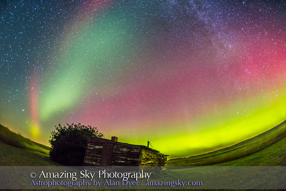The Northern Lights shot at the old Larson Ranch site in the Frenchman Valley at Grasslands National Park, Saskatchewan, August 27/28, 2014. The pioneer cabin was the home of the legendary western author and movie star Will James, born Ernest Dufault in Quebec. He lived in this cabin when he worked the ranches in the area. The aurora was excellent this night. This is a single 1-minute exposures at ISO 2500 with the 15mm full-frame fish-eye lens at f/3.2 and the Canon 6D.