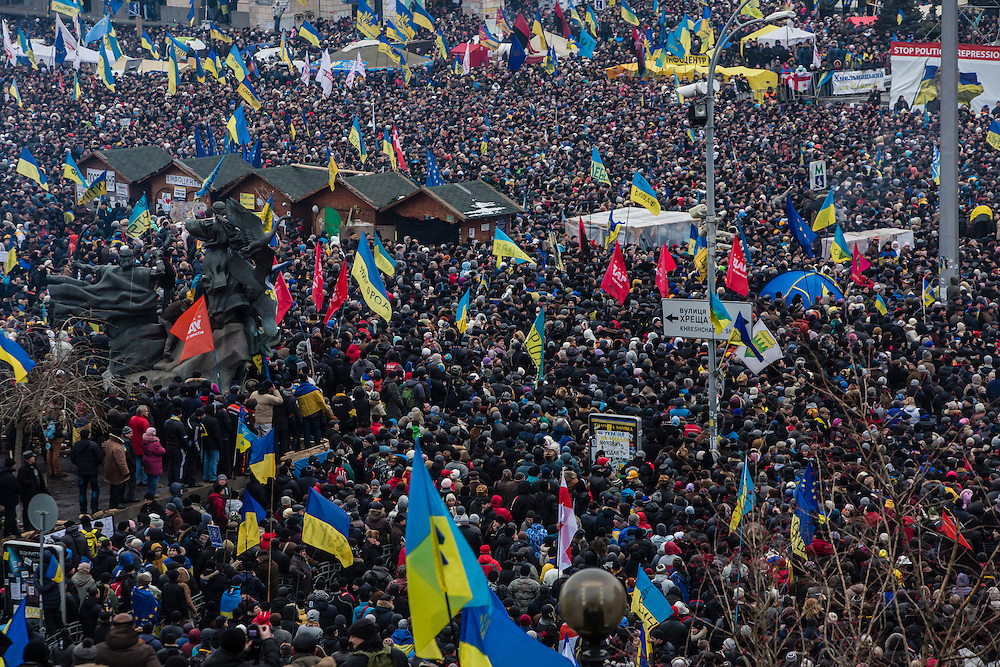 KIEV, UKRAINE - DECEMBER 15: A large crowd of anti-government protesters gathers on Independence Square for a rally on December 15, 2013 in Kiev, Ukraine. Thousands of people have been protesting against the government since a decision by Ukrainian president Viktor Yanukovych to suspend a trade and partnership agreement with the European Union in favor of incentives from Russia. (Photo by Brendan Hoffman/Getty Images) *** Local Caption ***
