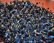 "Graduates toss their mortar boards in the air at the Oxford High graduation ceremony at the C.M. ""Tad"" Smith Coliseum in Oxford, Miss. on Friday, May 24, 2013."