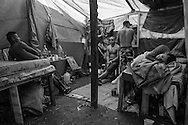Teenagers hangout in one of the shelters in Copa do Povo (People's Cup) Camp in Itaquera, São Paulo. The Copa do Povo Camp, is just a few miles from the Arena Corinthians and has 5,000 homeless workers and their families occupied area of fifteen acres. They are homeless after rents skyrocketed because of the World Cup. (Eduardo Leal).
