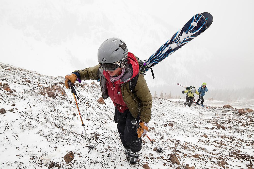 Backcountry skiers climb the loose talus slopes of Hayden Peak, San Juan Mountains, Colorado.