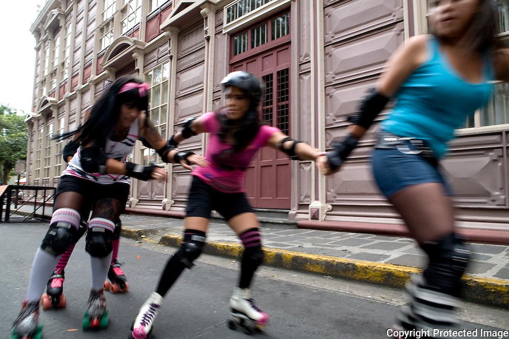 Roller Derby team practices in Parque Espana Saturday. Gabriella Sottela (Bloody Doll) passes under her team mates.