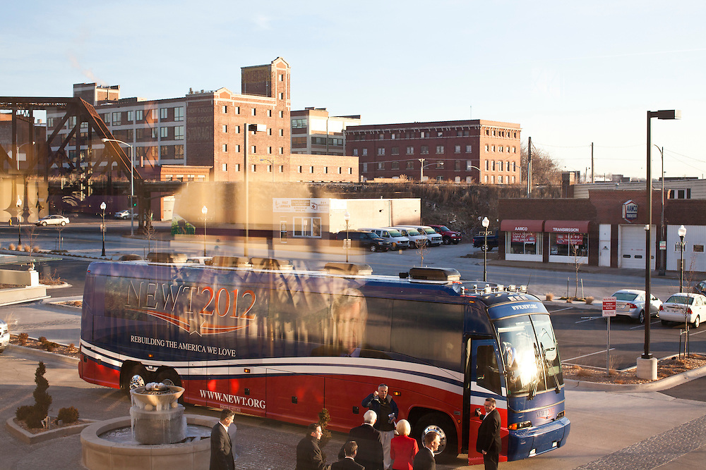 Republican presidential candidate Newt Gingrich boards his bus en route Muscatine at the Hotel Blackhawk on Tuesday, January 3, 2012 in Davenport, IA.