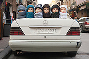 Mannequin heads model super-furry hijabs  on a car boot, Damascus, Syria