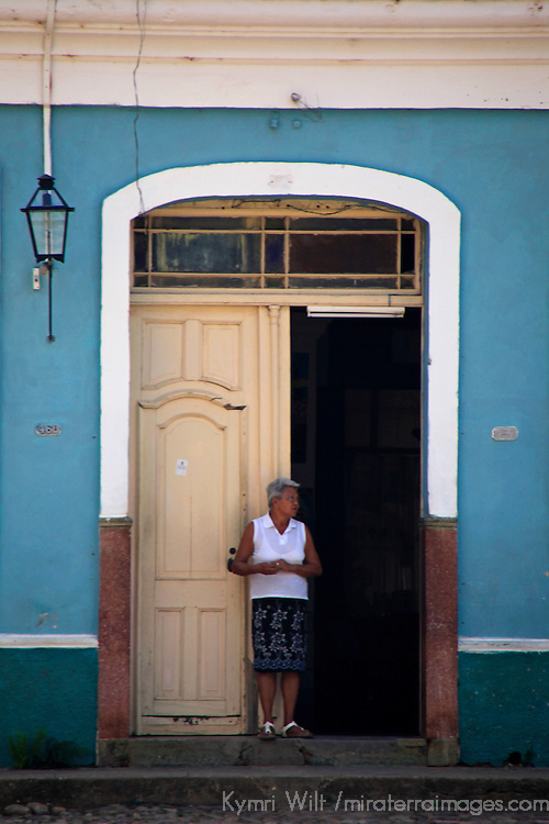 Central America, Cuba, Trinidad. Woman in doorway, Trinidad.