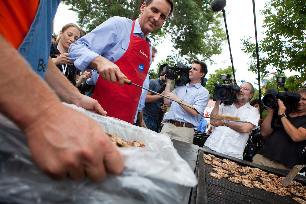 Republican presidential hopeful Tim Pawlenty mans the grill at the Iowa Pork Producers booth at the Iowa State Fair on Friday, August 12, 2011 in Des Moines, IA.