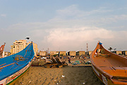 Fishing boats on the beach of Santhome. Santhome Beach and adjoining Marina Beach in Chennai, India were hit hard by the 2004 Tsunami. Fishermen and their families were the main victims living in their lightweight huts on the long and flat beaches of the area. All structures within 300 metres of the sea have now been banned and any left standing after the Tsunami were demolished. The fishermen and their families have now been relocated to government blocks of flats which has become a Santhome slum for fishermen and their families.