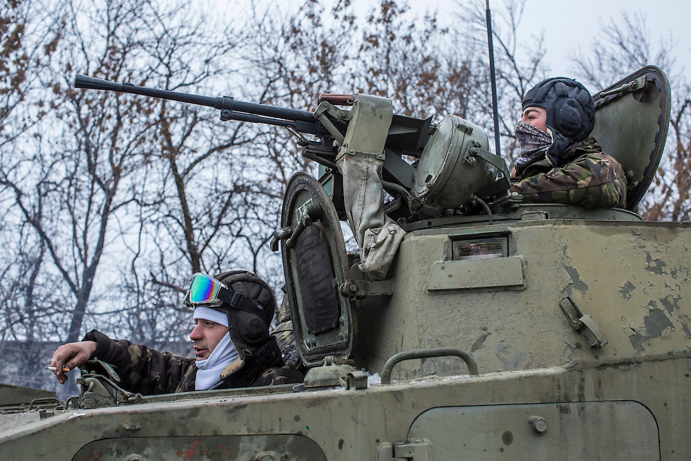 ARTEMIVSK, UKRAINE - FEBRUARY 16: Ukrainian soldiers prepare to drive in the direction of the embattled town of Debaltseve on February 16, 2015 in Artemivsk, Ukraine. A ceasefire that went into effect two days ago has been generally respected aside from Debaltseve, where pro-Russian rebels claim to have surrounded thousands of Ukrainian fighters and the battle continues. (Photo by Brendan Hoffman/Getty Images) *** Local Caption ***