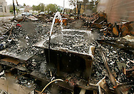This picture story consists of images from Hurricanes Katrina, Rita and Wilma.....This picture: A broken water line pours into a bathtub filled with charcoal after a block of buildings burned to the ground in downtown Galveston, Texas in the aftermath of Hurricane Rita September 24, 2005. ..