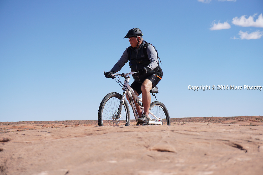 SHOT 10/18/16 12:06:24 PM - Emery County Utah tourism photos including hiking and exploring Goblin Valley including an arch rappel, the Black Dragon Canyon and  mountain biking Saucer Basin with Lamar Guymon. (Photo by Marc Piscotty / © 2016)