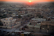 The Sun is setting over the city of Fallujah, Iraq.