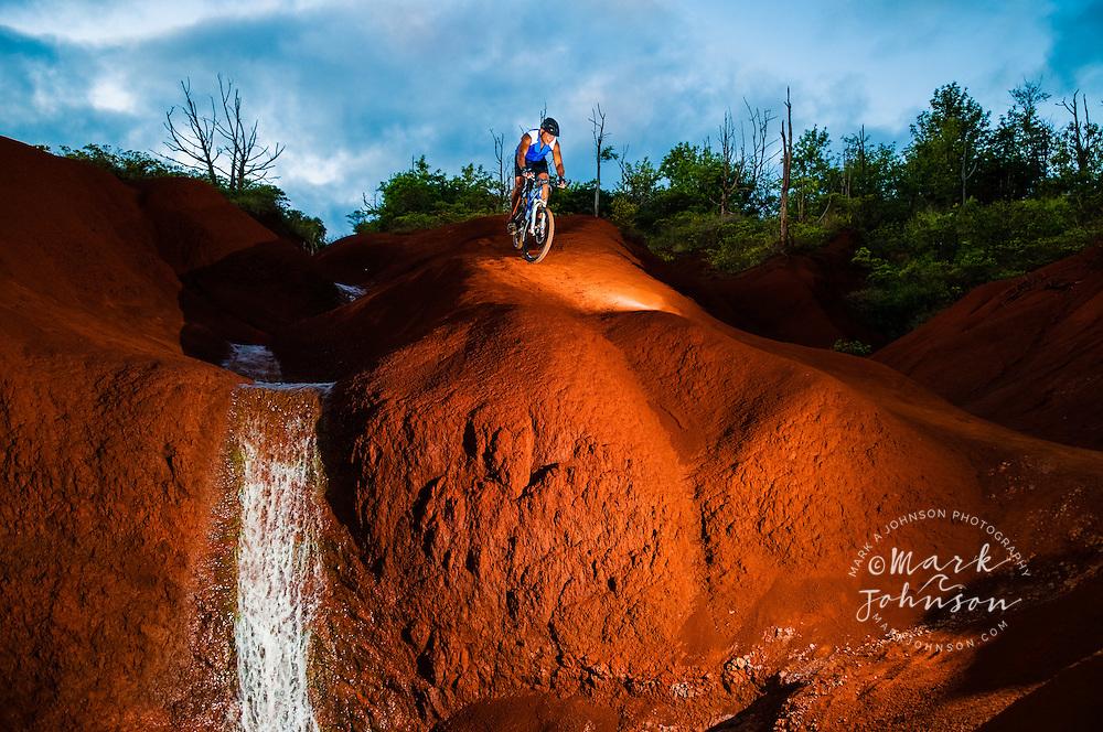 Man Biking Downhill