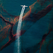 A C-130 plane sprays dispersant the Deepwater Horizon oil spill in the Gulf of Mexico, May, 2010.