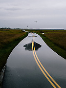 A road cutting through Blackwater NWR is flooded. The road, which used to flood on occasion, now regularly floods during high tide. People plan their schedules around high tide, whether it's running errands or getting out of work. It has even affected the timing of school buses which need to use the road.