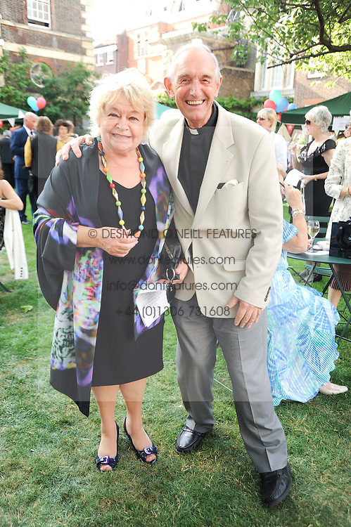 SANDY CHALMERS and CANON ROGER ROYLE at the Lord's Taverners Diamond Jubilee Garden Party held in College Gardens, Westminster Abbey, London on 8th July 2010.