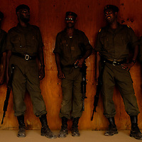 Djiboutian policemen lean on a wall during a short break in training on Nov. 16, 2005..Djiboutian police train in counter terrorism messures with the US Marine Corps off the Horn of Africa.