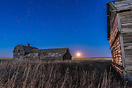 The rising Hunter's Full Moon on October 27, 2015, at the old barn near home in southern Alberta. This is one frame from a time-lapse sequence, with a 3-second exposure at f/5.6 and ISO 3200 with the Nikon D750 and Sigma 24mm.