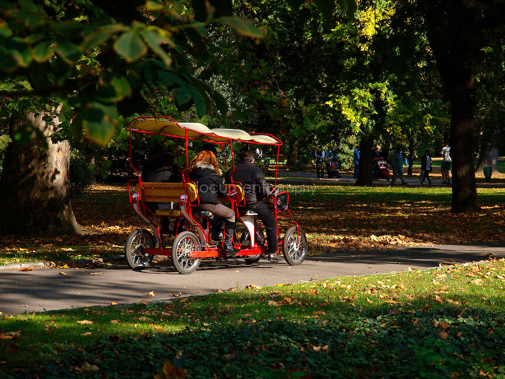 People on a pedal car in Margitsziget (Margaret Island) park, Budapest, Hungary.