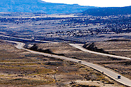Cutting through rock formations and rolling along the high desert, Interstate 70 runs through some harsh land in eastern Utah.