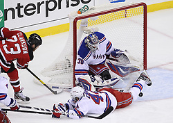 May 21, 2012; Newark, NJ, USA; New York Rangers defenseman Steve Eminger (44) blocks a shot in front of New York Rangers goalie Henrik Lundqvist (30) during the first period in game four of the 2012 Eastern Conference Finals at the Prudential Center.