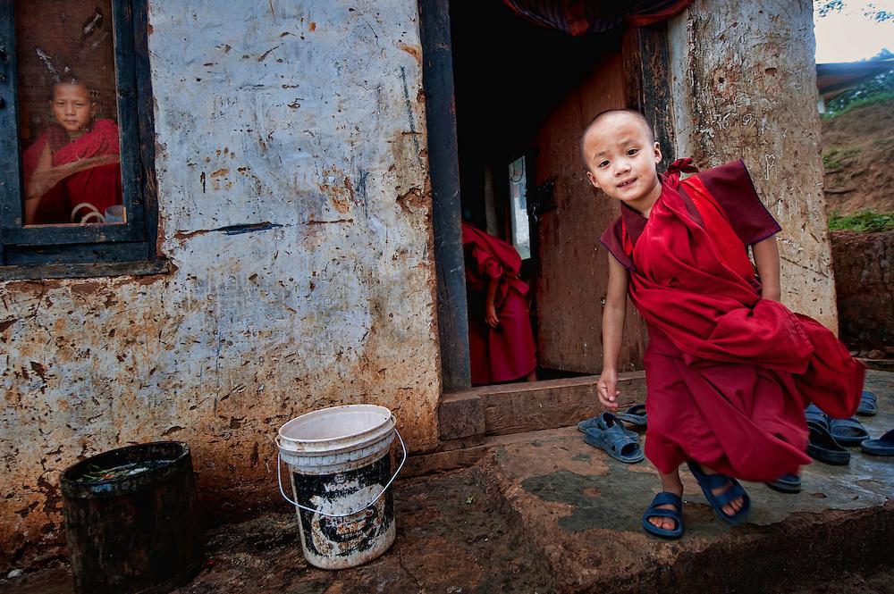 Asia, Bhutan, little monks at Chimi Lhakhang monastery monastry
