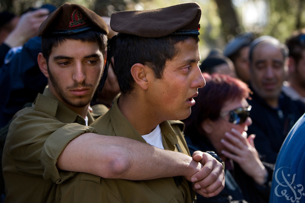 Israeli soldiers grieve for Staff Sgt. Nitai Stern, 21, who died in an operation in the Gaza Strip Monday, during his funeral at the Mt. Herzl cemetery in Jerusalem, Tuesday, Jan. 6, 2009. Stern and two other soldiers were killed when an Israeli tank shell mistakenly fired on their position in an apparent friendly-fire incident, Israeli sources said.