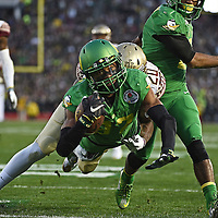 Darren Carrington dives into the end zone to score during the third quarter of the Rose Bowl against Florida on Thursday.