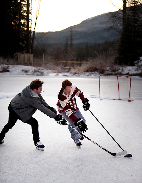 An evening hockey game on a frozen pond.  Whistle BC, Canada.